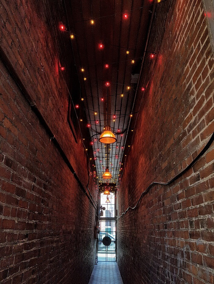Light Installation - Red and Warm White Super-Bright Globe Lights In Alley Commercial Christmas