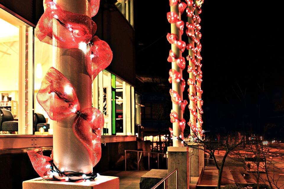 Christmas Light Installation - Red Tule Garland and Red and White Mini-lights Wrapped on Columns