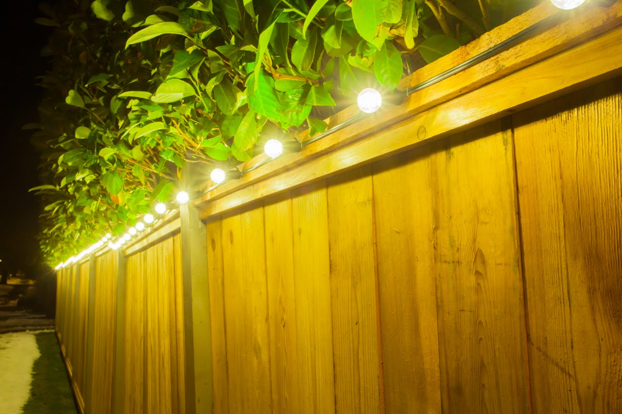 Christmas Residential Lighting Installation - Warm White Globe Lights on Fence Line