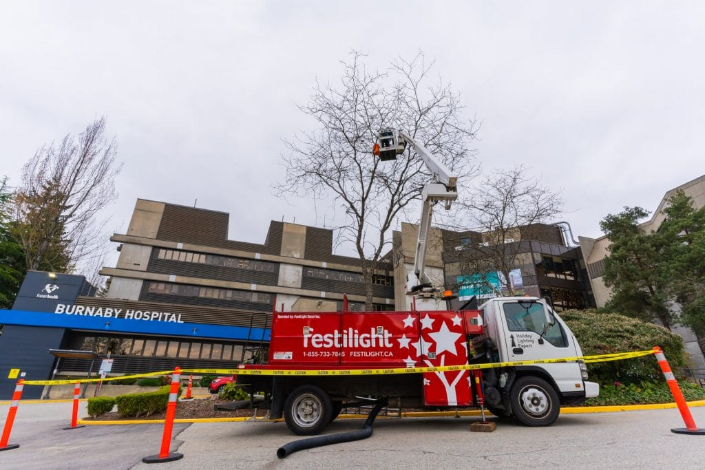 Big Red Bucket Truck Installing Lights at Burnaby General Hospital